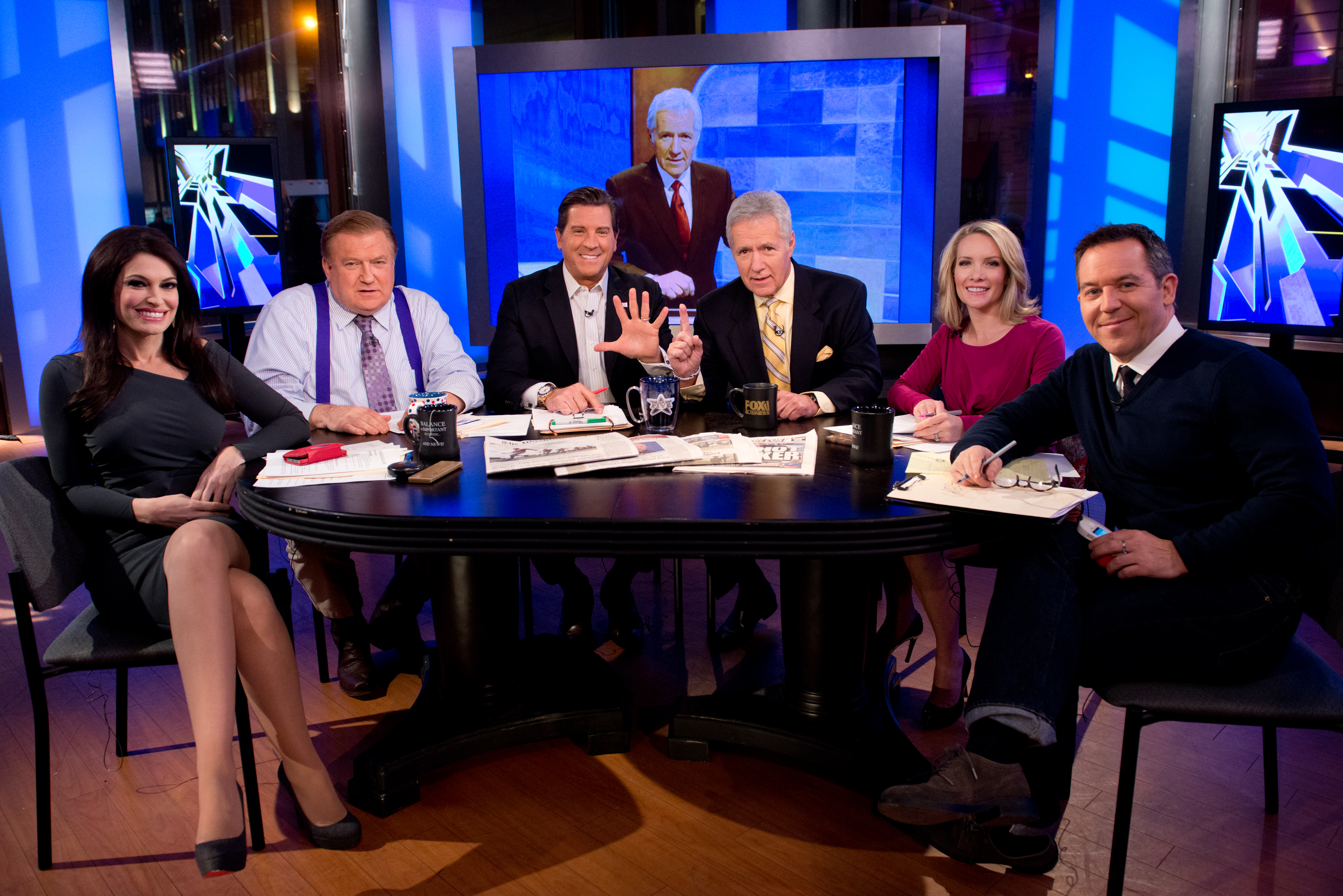 "TV personality Alex Trebek, third from right, and the hosts of 'The Five,' left to right, Kimberly Guilfoyle, Bob Beckel, Eric Bolling, Dana Perino and Greg Gutfeld attend FOX News' ""The Five"" at FOX Studios on February 26, 2014 in New York City.  (Photo by Noam Galai/Getty Images)"