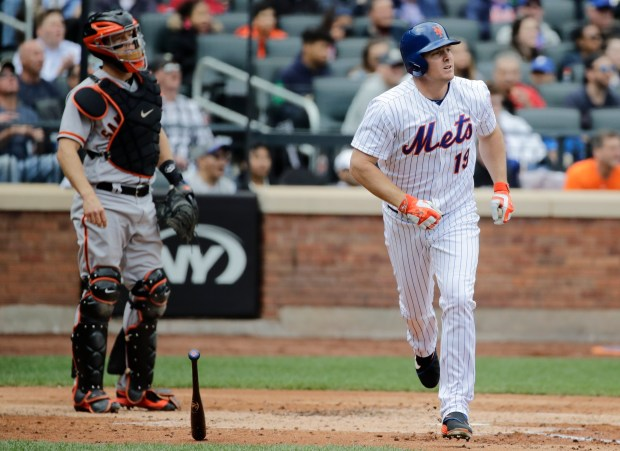 San Francisco Giants catcher Nick Hundley, left, watches as New York Mets' Jay Bruce (19) runs the bases after hitting a home run during the third inning of a baseball game Wednesday, May 10, 2017, in New York. (AP Photo/Frank Franklin II)