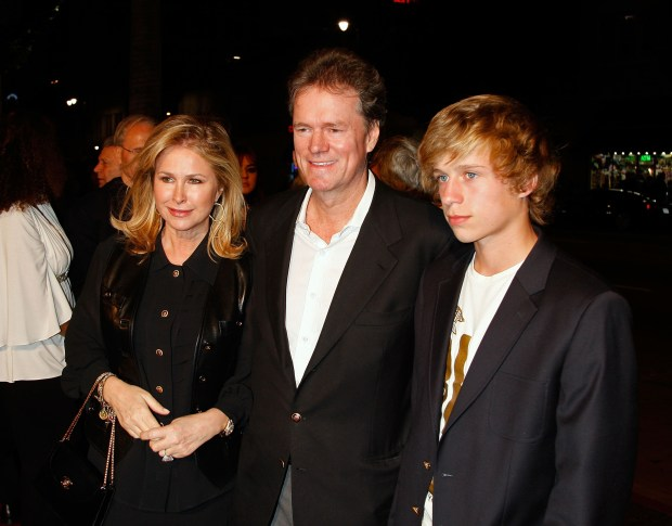 """HOLLYWOOD - FEBRUARY 04: (L-R) Kathy, Rick, and Conrad Hughes Hilton arrive at the premiere for """"The Hottie & The Nottie"""" held at the Egyptian Theatre on February 4, 2008 in Hollywood, California. (Photo by Kevin Winter/Getty Images)"""