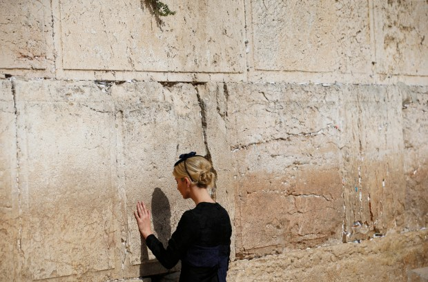 Ivanka Trump touches the Western Wall, Judaism's holiest prayer site, in Jerusalem's Old City Monday,May 22, 2017. (Ronen Zvulun, Reuters Pool via AP)
