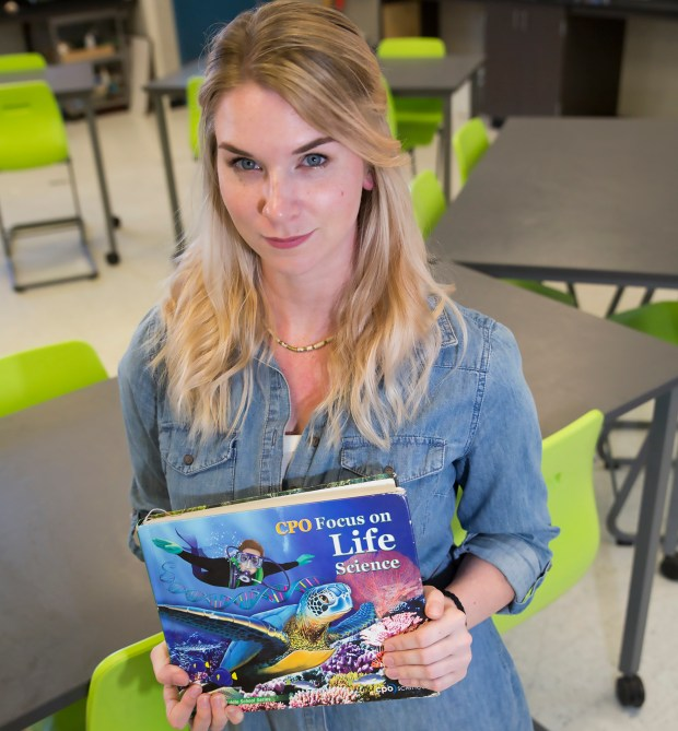 "Photo Jacqueline Ramseyer/Bay Area News Group/May 5, 2017Cupertino Middle School seventh-grade science teacher Rachel Nolan with the Life Science book she is currently using to teach her students about sexual education. This book has four pages that will teach seventh-graders about parts of the male and female anatomy, how a woman becomes pregnant and childbirth. What's not being taught, and what Nolan says most of her students are ""upset they're not learning it,"" are scenarios about boundaries, consent and harassment, to name a few."