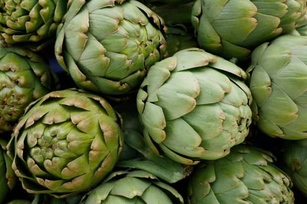 Artichokes from Spade and Plow of Santa Clara County are displayed for sale as the Downtown San Jose Farmers' Market opens for its 25th season Friday, May 5, 2017, in San Jose, Calif. (Jim Gensheimer/Bay Area News Group)