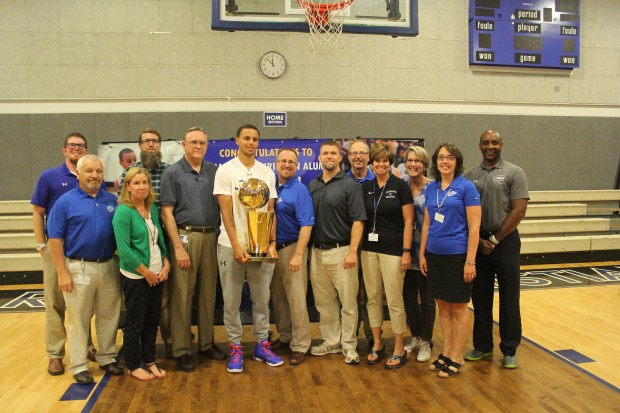 Stephen Curry, center, poses with former teachers and the NBA championship trophy during a visit to his alma mater, Charlotte Christian School in September of 2015. (Courtesy Charlotte Christian School)