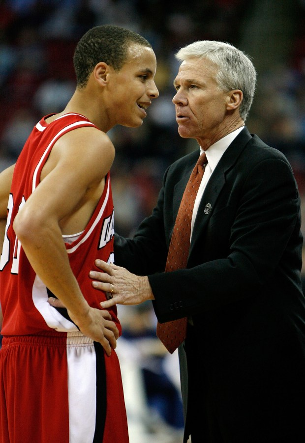 Stephen Curry of the Davidson Wildcats, left, talks to head coach Bob McKillop in their game against the Gonzaga Bulldogs during the 1st round of the 2008 NCAA Men's Basketball Tournament on March 21, 2008 at RBC Center in Raleigh, North Carolina. (Photo by Streeter Lecka/Getty Images)