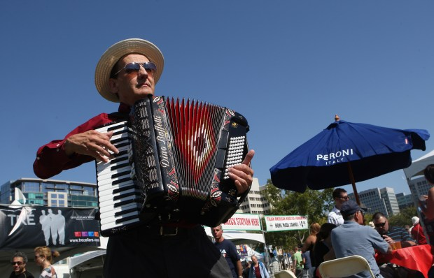 Mike Zampiceni plays accordion during the Italian Family Festa at Guadalupe River Park in San Jose, Calif. on Saturday, Aug. 25, 2012. (Jim Gensheimer/Staff)