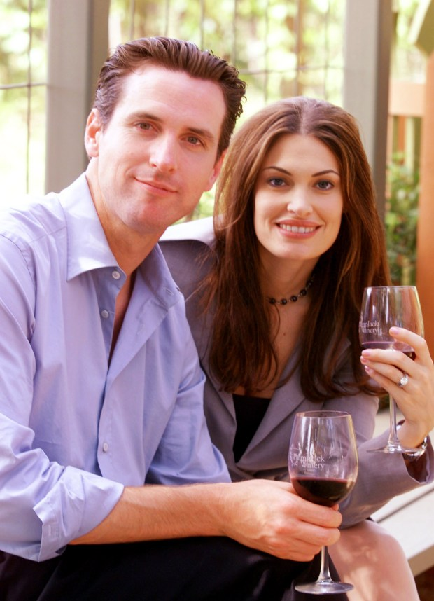 Gavin Newsom, left, and his wife, Kimberly Guilfoyle Newsom, right, pose for a picture at the PlumpJack winery in Oakville, Calif., Friday June 7, 2002. San Francisco Mayor Gavin Newsom and his wife, Court TV legal analyst Kimberly Guilfoyle Newsom, are filing for divorce after three years of marriage. In a joint statement issued Wednesday by the mayor's office, the Newsoms cited the strain posed by their high-profile, bicoastal careers as the reason for the split. (AP Photo/Eric Risberg)