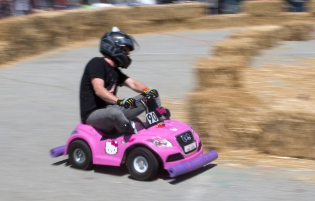 "Donald Bell, of Alameda, drives ""Kitty Grabs Back"" in the toy car races at the Maker Faire at the San Mateo Event Center in San Mateo, Calif., Saturday, May 20, 2017. This weekend's Maker Faire is a showcase of invention, earsplitting pyrotechnics, robots, crafts and large-scale art. (Patrick Tehan/Bay Area News Group)"