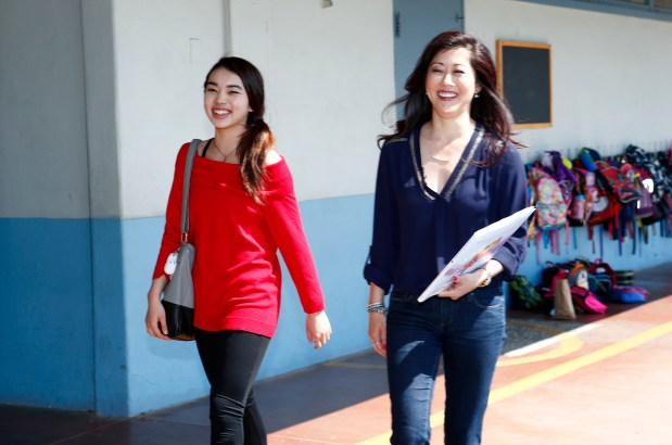 Karen Chen, U.S. skating champion, left, and Kristi Yamaguchi, Olympic skating gold medalist, right, arrive at Glenmoor Elementary School in Fremont, Calif., on Friday, May 12, 2017. The skating champions came to the school to help celebrate kindergarten graduation. (Gary Reyes/ Bay Area News Group)