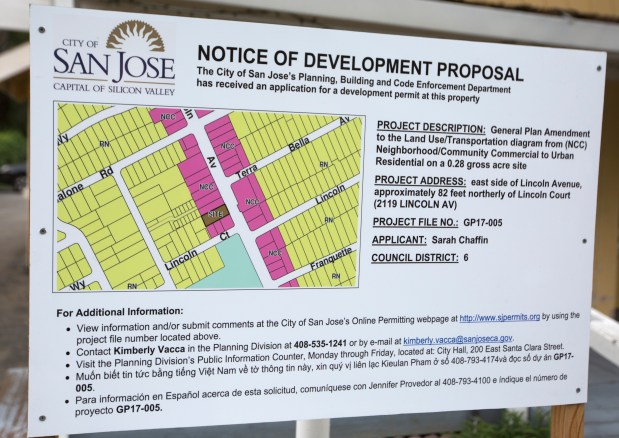 A notice of development sign is posted outside a business property on Lincoln Avenue -- the site of the proposed affordable teacher housing development -- in San Jose, Calif., Saturday, May 6, 2017. Neighborhood activists are battling San Jose City Hall to build affordable apartments for teachers at the location. The project faces opposition because of a vow from elected officials to stop allowing housing on land that's zoned for jobs. (Patrick Tehan/Bay Area News Group)