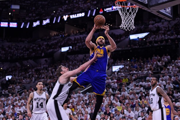 Golden State Warriors' JaVale McGee (1) shoots a basket past San Antonio Spurs' Pau Gasol (16) during the second quarter of Game 3 of the NBA Western Conference Finals at AT&T Center in San Antonio, Texas, on Saturday, May 20, 2017. (Jose Carlos Fajardo/Bay Area News Group)