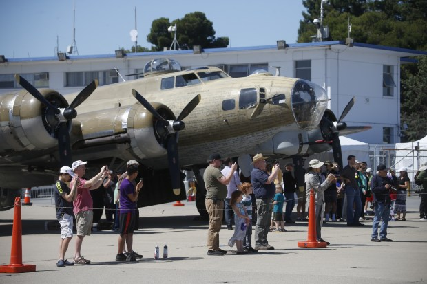 People wait in line to climb the steps of a B-17 bomber, Sunday, May 21, 2017, at the Wings of Freedom show at Moffett Field in Mountain View, Calif. (Karl Mondon/Bay Area News Group)