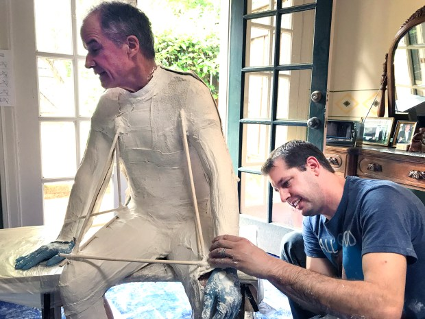 Photograph by Brandy Miceli Anthony Teixeira, Jerry Smith's long-time sculpture partner, is pictured administering a casting of Bill Peck, which will come to be the body of Willys Peck, for the Peck Bronze Project. The final product will be revealed in Blaney Plaza in August.