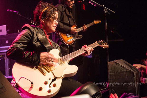 Wendy Melvoin plays guitar during a show by the Revolution in 2017. Photo by Robert Georgeff