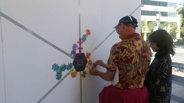 """Visitors to Palo Alto participate with """"urban intervention"""" installations of the Code:Art festival meant to activate unused public spaces in the city. (Jacqueline Lee / Daily News)"""