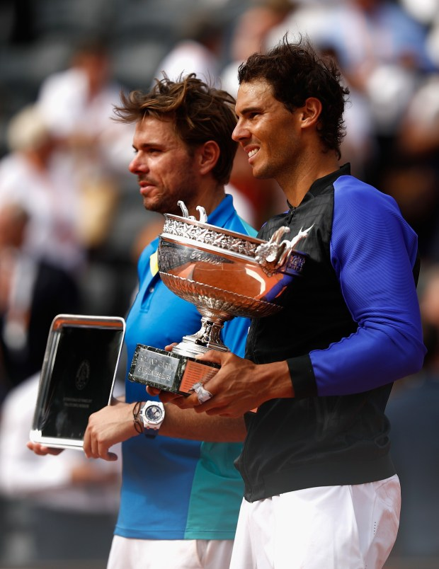Rafael Nadal of Spain, right, and Stan Wawrinka of Switzerland pose with their trophies. (Photo by Adam Pretty/Getty Images)