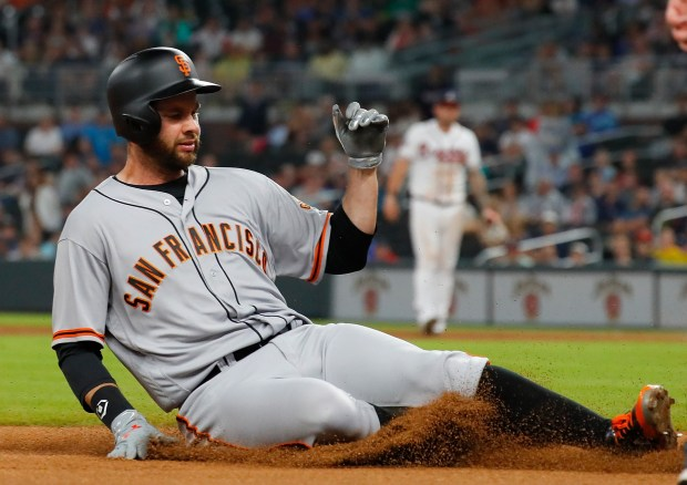 ATLANTA, GA - JUNE 21: Brandon Belt #9 of the San Francisco Giants slides safely into third base on a RBI triple that scored Hunter Pence #8 in the second inning against the Atlanta Braves at SunTrust Park on June 21, 2017 in Atlanta, Georgia. (Photo by Kevin C. Cox/Getty Images)