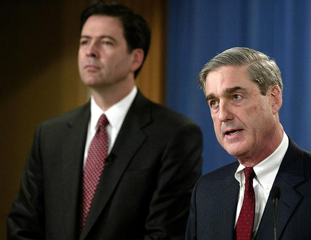 2004: James Comey (left), then deputy attorney general, with Robert Mueller, then FBI director. (AFP Getty)