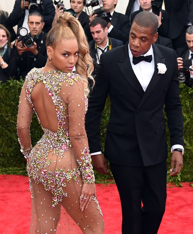 This file photo taken on May 4, 2015 shows Beyonce and Jay Z arriving at the Metropolitan Museum of Art's Costume Institute Gala benefit in honor of the museums latest exhibit China: Through the Looking Glass in New York. Pop diva Beyonce and her rap mogul husband Jay-Z have welcomed twins, according to multiple US media reports, with two new members joining music's royal family that already includes five-year-old Blue Ivy. (Timothy A. Clary/AFP/Getty Images