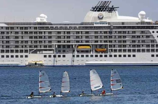 Small sailboats from the Monterey Yacht Club head out in front of The World on Tuesday. (Vern Fisher - Monterey Herald)