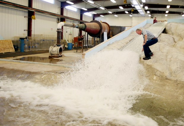 Michael Johnson looks at the water flow on a replica of the Oroville Dam spillway at Utah State University's Water Research Laboratory, in Logan, Utah. (AP Photo/Rick Bowmer)