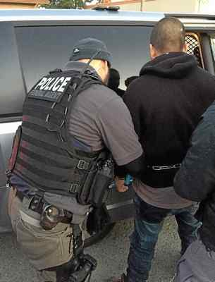 An immigrant is arrested this week by Immigration and Customs Enforcement agents in Central California. Federal agents arrested 54 immigrants in the second major roundup in the area since January. (Immigration Customs Enforcement -- Contributed)
