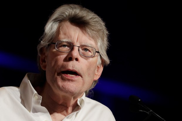 "FILE - In this June 1, 2017 file photo, author Stephen King speaks at Book Expo America in New York. King says his frequent criticism of President Donald Trump has gotten him blocked by America's head of state on Twitter. The author of ""Firestarter"" and ""It"" tweeted on Tuesday, June 13, 2017, that Trump has blocked him on the social media website. (AP Photo/Mark Lennihan, File)"