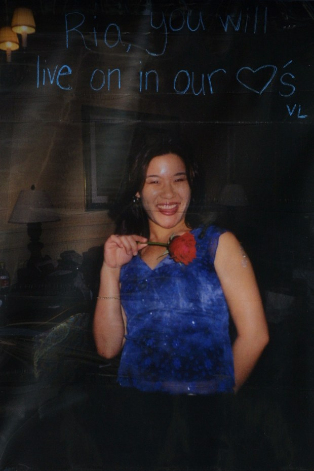 A flower memorial to Maria A. Hsiao is outside of Q bar in Palo Alto where the young woman was killed during a shooting. A poster with her photo is part of the memorial. Jim Gensheimer/ Bay Area News Group