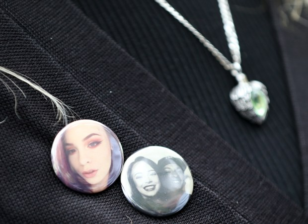 Kimberly Gregory wears buttons with photos of her daughter Michela Gregory and boyfriend Alex Vega two of the 36 victims to perish in the Ghost Ship fire as she leaves the Wiley W. Manuel Courthouse after attending a court appearance by Ghost Ship master tenant Derick Almena at the courthouse on Thursday, June 8, 2017. Almena has been charged with 36 counts of involuntary manslaughter in connection with the Dec. 2 warehouse fire. (Anda Chu/Bay Area News Group)