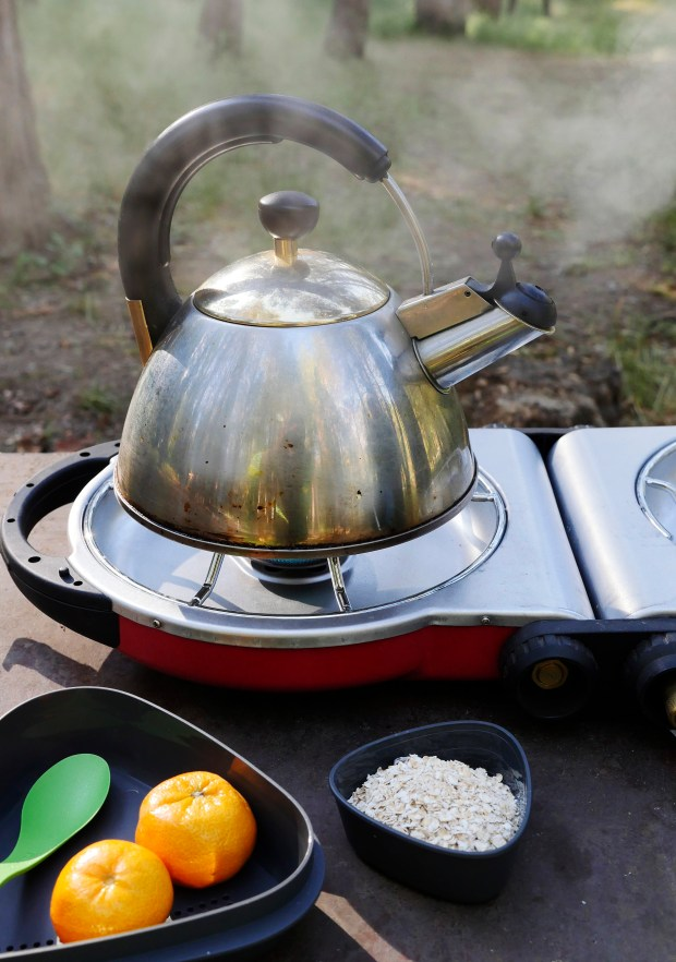 A kettle heats water for oatmeal at a campsite at Wawona Campground on Friday, May 26, 2017, in Yosemite National Park, Calif. (Jim Gensheimer/Bay Area News Group)