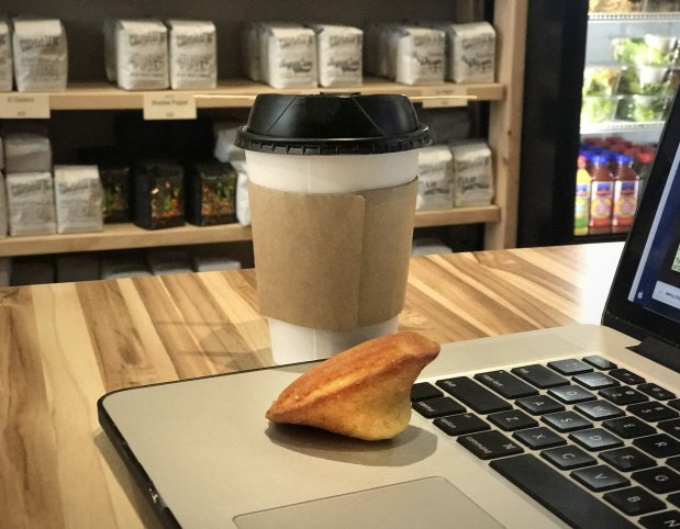 A cup of Chromatic's Holy Mountain, a vanilla madeleine -- and the laptop. (Paul Baca/Bay Area News Group)