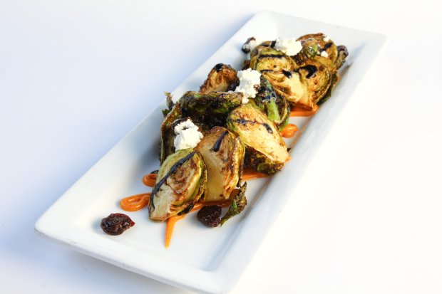 A Crispy Brussels Sprouts appetizer at Avila Beach's Ocean Grill is adornedwith dried cherries, goat cheese, smoked paprika aioli and a balsamic reduction. (Photo: Ocean Grill)