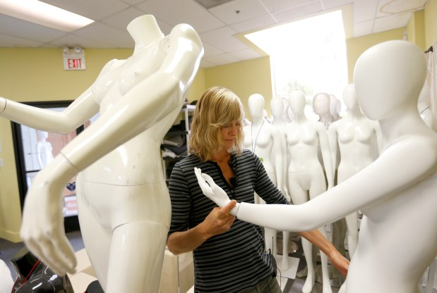 Artist Angelique Benicio, of San Rafael, picks out mannequins at the Mannequin Madness retail store and warehouse in Oakland, Calif., on Tuesday, June 27, 2017. She plans to use them in an art installation project. Owner Judi Townsend, of Oakland, began the business of renting, selling, repairing and recycling mannequins in 2002, and now also rents an onsite photo studio. (Jane Tyska/Bay Area News Group)