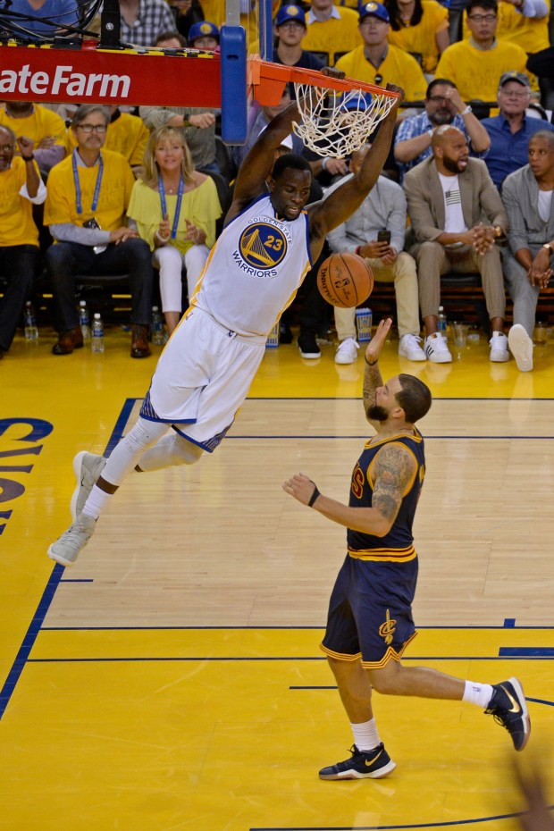 Golden State Warriors' Draymond Green (23) dunks the ball past Cleveland Cavaliers' Deron Williams (31) during the fourth quarter of Game 1 of the NBA Finals at Oracle Arena in Oakland, Calif., on Thursday, June 1, 2017. The Golden State Warriors defeated the Cleveland Cavaliers 113-91. (Jose Carlos Fajardo/Bay Area News Group)