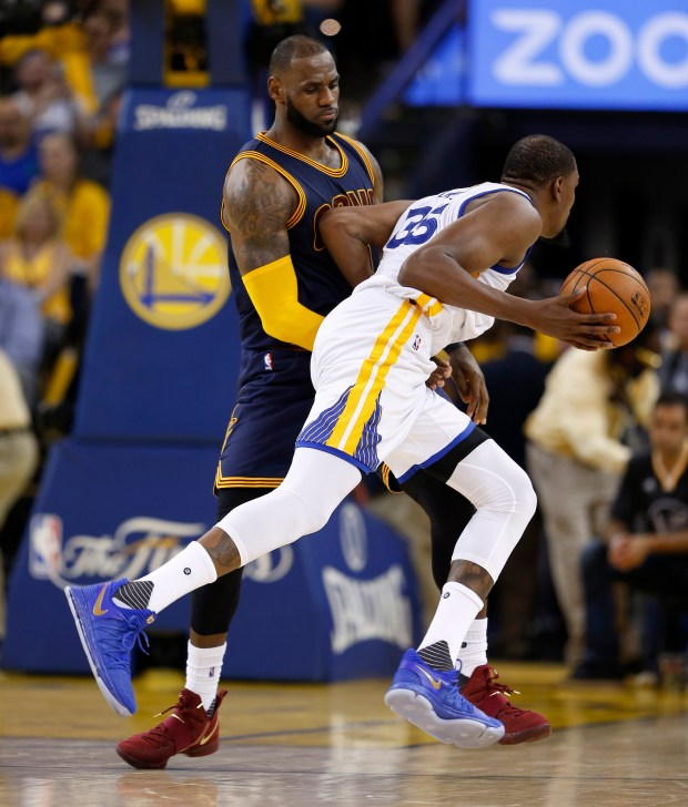 Cleveland Cavaliers' LeBron James (23) fouls against Golden State Warriors' Kevin Durant (35) in the fourth quarter of Game 1 of the NBA Finals at Oracle Arena in Oakland, Calif., on Thursday, June 1, 2017. (Nhat V. Meyer/Bay Area News Group)
