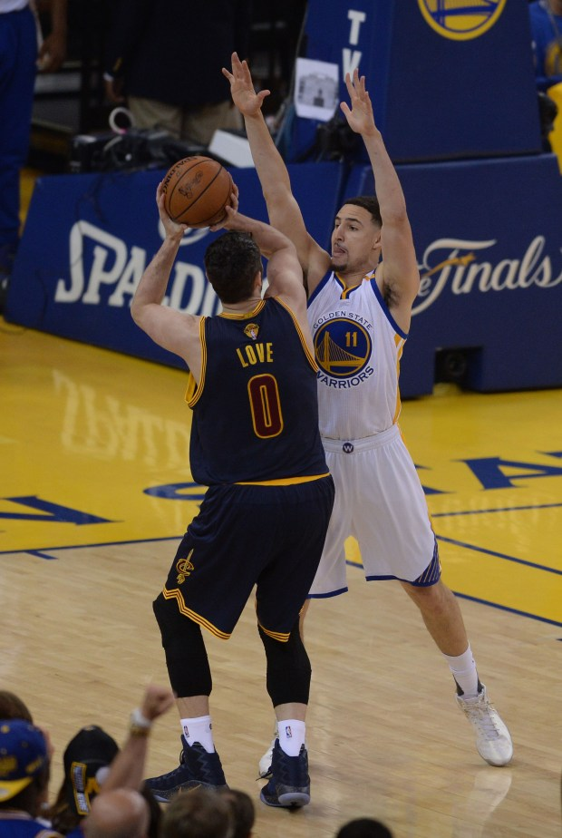 The Golden State Warriors' Klay Thompson (11) plays touch defense against the Cleveland Cavaliers' Kevin Love (0) in the first quarter of Game 1 of The Finals at Oracle Arena in Oakland, Calif., on Tuesday, June 1, 2017. (Dan Honda/Bay Area News Group)