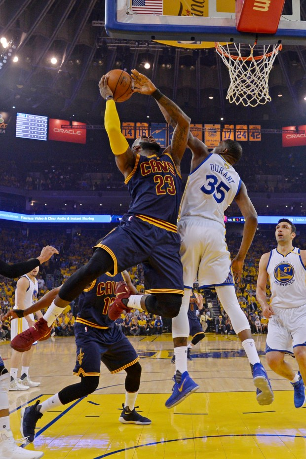 Golden State Warriors' Kevin Durant (35) blocks a shot by Cleveland Cavaliers' LeBron James (23) during the first quarter of Game 1 of the NBA Finals at Oracle Arena in Oakland, Calif., on Thursday, June 1, 2017. The Golden State Warriors defeated the Cleveland Cavaliers 113-91. (Jose Carlos Fajardo/Bay Area News Group)