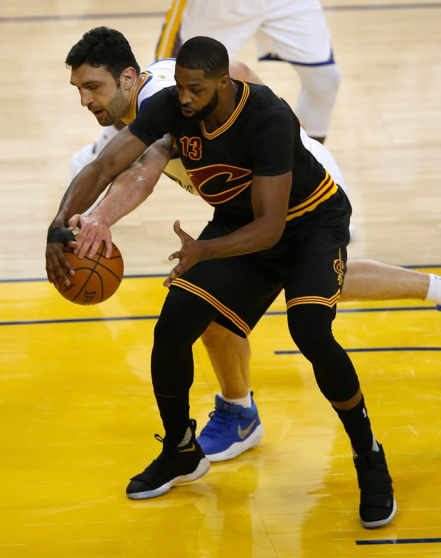 Golden State Warriors' Zaza Pachulia (27) fights for the ball against Cleveland Cavaliers' Tristan Thompson (13) in the first quarter of Game 2 of the NBA Finals at Oracle Arena in Oakland, Calif., on Sunday, June 4, 2017. (Nhat V. Meyer/Bay Area News Group)