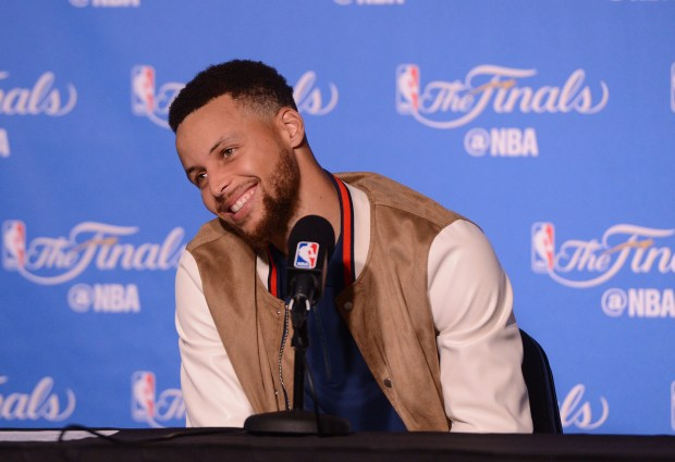 The Golden State Warriors' Stephen Curry (30) smiles during a press conference following Game 2 of the NBA Finals between the Golden State Warriors and the Cleveland Cavaliers at Oracle Arena in Oakland, Calif., on Sunday, June 4, 2017. (Dan Honda/Bay Area News Group)
