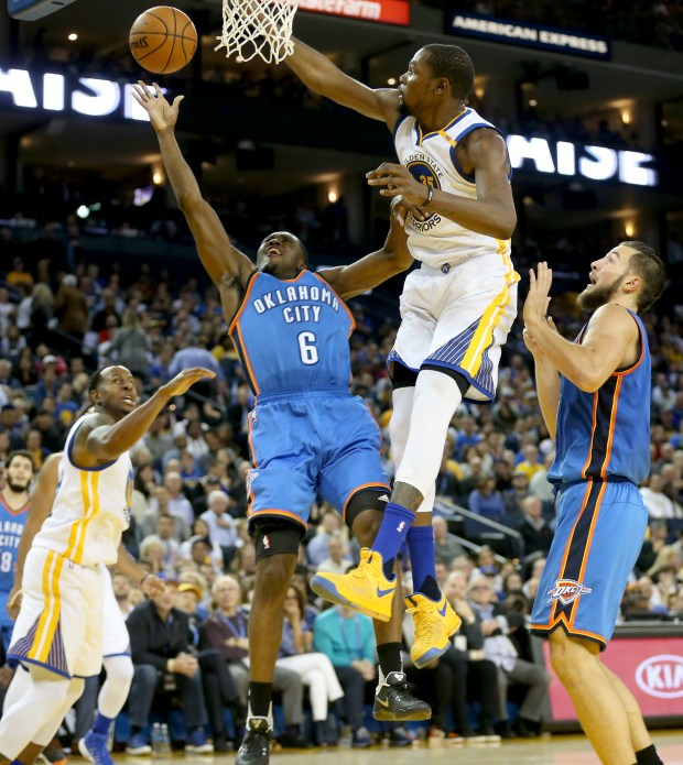 Golden State Warriors's Kevin Durant (35) blocks a shot against Oklahoma City Thunder's Semaj Christon (6) in the second half of a NBA game at Oracle Arena in Oakland, Calif., on Thursday, Nov. 3, 2016. (Ray Chavez/Bay Area News Group)