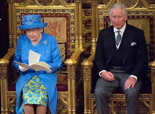Queen Elizabeth II delivers the Queen's Speech whilst sat next to Prince Charles, Prince of Wales during the State Opening of Parliament in the House of Lords at the Palace of Westminster on June 21, 2017 in London, United Kingdom. This year saw a scaled-back State opening of Parliament Ceremony with the Queen arriving by car rather than carriage and not wearing the Imperial State Crown or the Robes of State. (Photo by Arthur Edwards - WPA Pool/Getty Images)