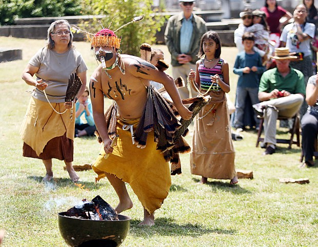 Amah Mutsun Tribal Band dancers honor their 2,000 ancestors buried in a previously unmarked grave at Old Holy Cross Cemetery on Wednesday. (Dan Coyro -- Santa Cruz Sentinel)