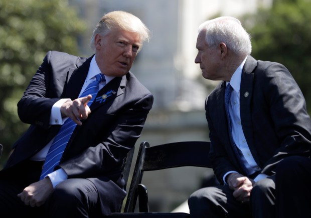 """FILE - In this May 15, 2017, file photo, President Donald Trump talks with Attorney General Jeff Sessions,at the 36th Annual National Peace Officers' memorial service on Capitol Hill in Washington.  Sessions did not disclose contacts with foreign dignitaries, including the Russian ambassador, on a security clearance form he filled out as a United States senator last year, the Justice Department acknowledged May 24. The department said Sessions' staff relied on the guidance of the FBI investigator handling the background check, who advised that meetings with foreign dignitaries """"connected with Senate activities"""" did not have to be reported on the form. (AP Photo/Evan Vucci, file)"""