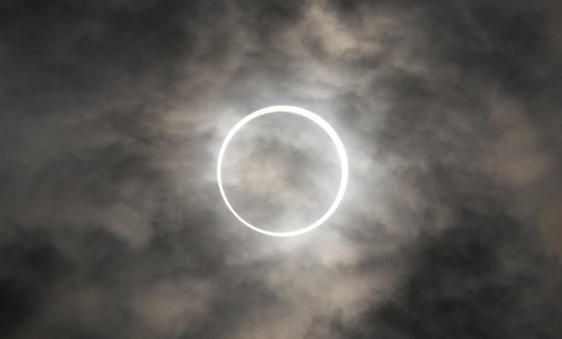 The sun is obscured by the moon during a solar eclipse seen in Tokyo, Japan May 21, 2012. (Tomohiro Ohsumi/Bloomberg)