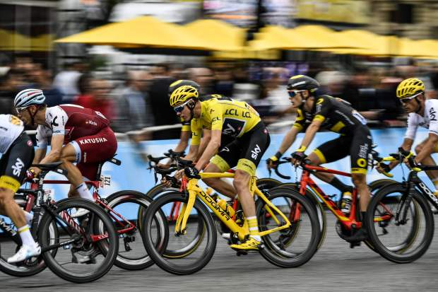 Great Britain's Christopher Froome (C) wearing the overall leader's yellow jersey, rides during the 103 km twenty-first and last stage of the 104th edition of the Tour de France cycling race on July 23, 2017 between Montgeron and Paris Champs-Elysees. / AFP PHOTO / PHILIPPE LOPEZPHILIPPE LOPEZ/AFP/Getty Images