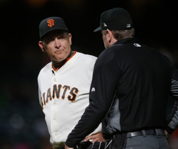 San Francisco Giants pitching coach Dave Righetti (19) has a few words with home plate umpire Chris Conroy (98) against the Pittsburgh Pirates in the ninth inning of their MLB game at AT&T Park in San Francisco, California, on Monday, July 24, 2017. (JosieLepe/Bay Area News Group)