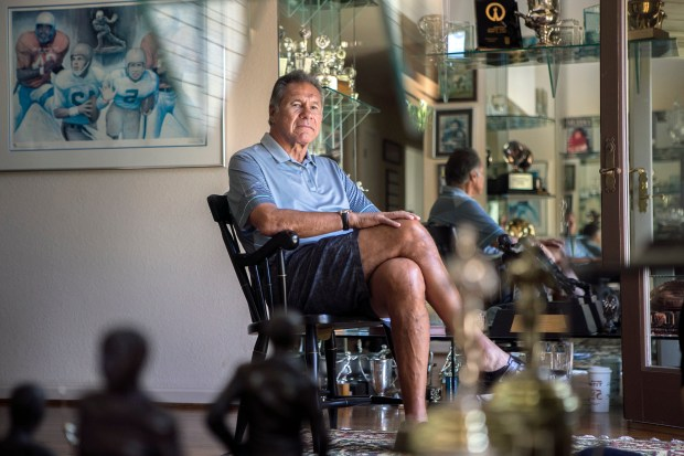 Former Stanford, 49ers and Raiders Quarterback Jim Plunkett poses for a portrait in the trophy room of his home in Atherton, California, on Wednesday, July 19, 2017. Plunkett has been struggling with various football related ailments. (LiPo Ching/Bay Area News Group)