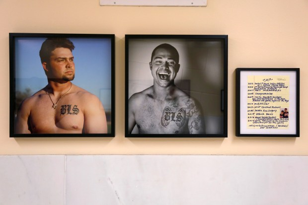 """Two photographs by Tabitha Soren, former MTV correspondent and now photographer, of former Oakland Athletic's Nick Swisher on display during the opening reception of her exhibition called """"Fantasy Life"""" at San Francisco City Hall in San Francisco, Calif. on Thursday, July 20, 2017. At right is a list of the teams he played for written in his handwriting. (Nhat V. Meyer/Bay Area News Group)"""