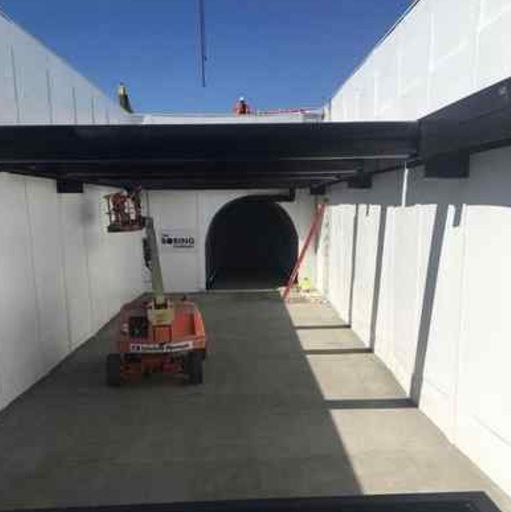 Elon Musk shared this photo of the entrance to The Boring Co.'s proposed Hawthorne-to-LAX tunnel in SpaceX's old parking lot on his Instagram account.