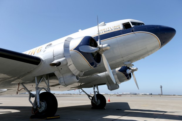 The Breitling DC-3 makes a stop at the Oakland International Airport before continuing on its around the world tour, in Oakland, Calif., on Wednesday, July 12, 2017. The restored 77-year-old aircraft, that helped to revolutionize air transportation, is also carrying 500 limited edition Breitling Navitimer watches on its journey. (Anda Chu/Bay Area News Group)