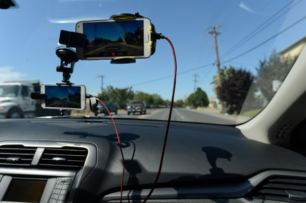"Smart phones mounted on the windshield of a car being driven RoadBotics CEO Mark DeSantis, along the streets of Pittsburg, Calif., on Friday, July 14, 2017. DeSantis is using his companies ""smart"" technology that allows your smart phone's video camera to gather data on the condition of the road it is recording in order to create a detailed map showing the damage level of the roads and streets being recorded. (Dan Honda/Bay Area News Group)"